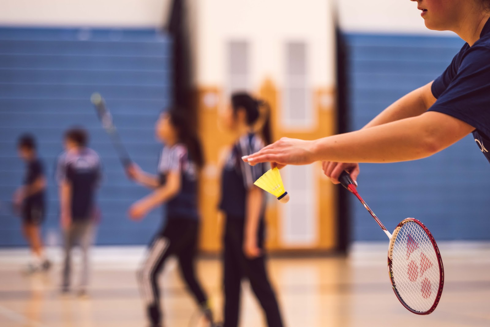 A group of students playing badminton